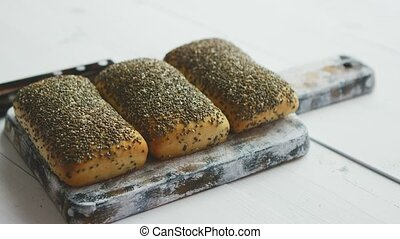 Closeup of whole grain bread with seeds on a rustic wooden...