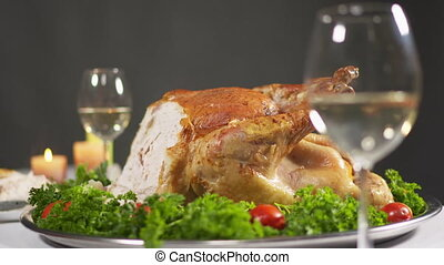 Closeup of whole roasted turkey garnished with tomatoes and...