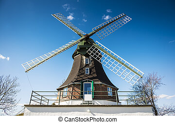 Closeup of windmill on the road