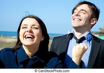 Closeup of winning happy business people full of joy