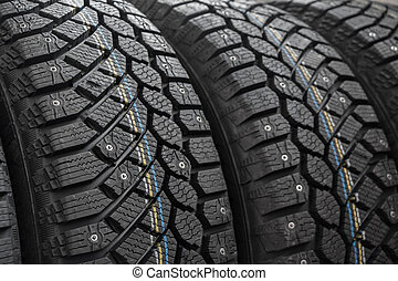 Closeup of winter car tire with snow spikes