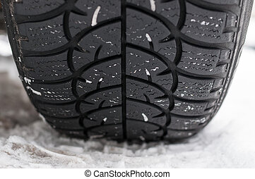 Closeup of Winter tyre on the road