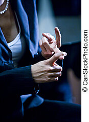 Closeup of woman counting on her fingers - Closeup of...