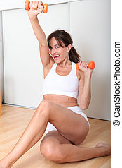 Closeup of woman doing fitness exercises