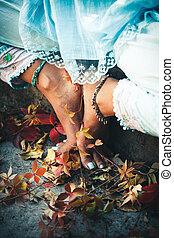 closeup of woman feet in yoga position outdoor - closeup of...