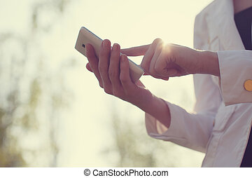 Closeup of woman hands using smartphone