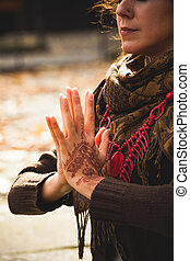 closeup of woman hands with henna drowing