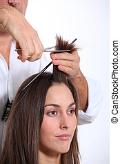 Closeup of woman having an haircut