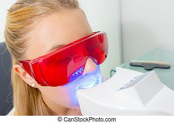 Closeup of woman having dental treatment