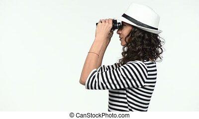Closeup of woman looking through binoculars