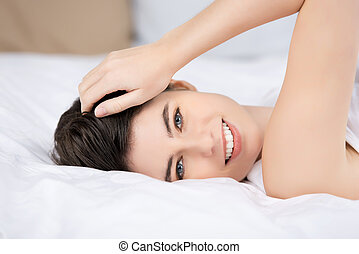 Closeup Of Woman Lying On Bed