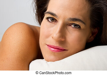 Closeup of woman on bed