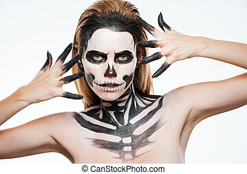 Closeup of woman with gothic terrifying makeup posing over white background