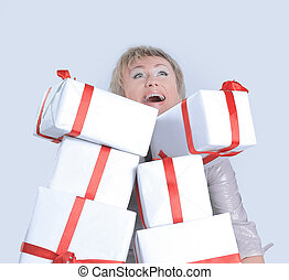 closeup of woman with lots of gift boxes.