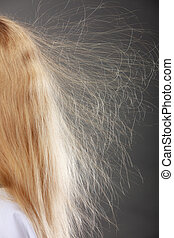 Closeup of woman with static blonde hair. - Closeup of woman...
