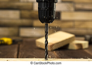 Closeup of wood drill bit with sawdust