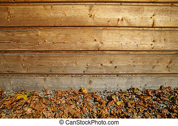wooden fence and autumn leaves