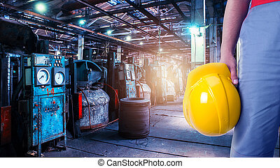 Closeup of worker man with yellow helmet