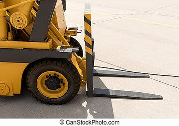 Closeup of yellow forklift truck