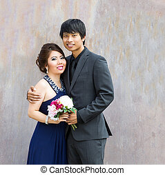 Closeup of Young Adult Couple holding each other on a date