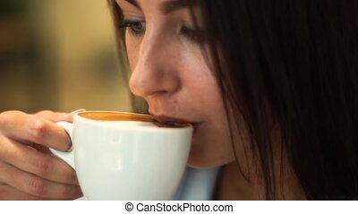 Closeup of Young Attractive Woman Drinking Coffee