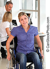 Closeup of young handicapped worker in the office