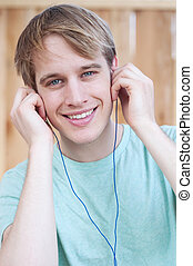 closeup of young male listening to music