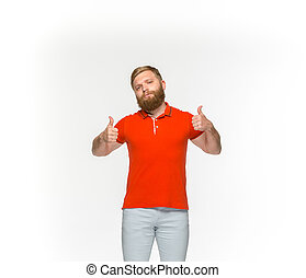 Closeup of young man's body in empty red t-shirt isolated on white background. Mock up for disign concept