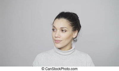Closeup of young mixed race woman looking at sides
