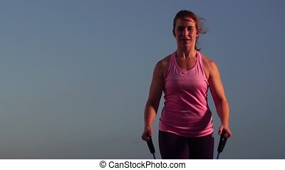 Closeup of Young Sportswoman Working Out with Resistance...