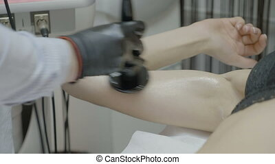 Closeup of young woman arm having skin revitalizing and...