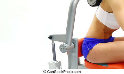 Closeup of young woman on isodynamic exerciser