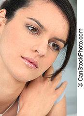 Closeup of young woman pensive