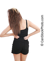 Closeup of young woman suffering from back pain