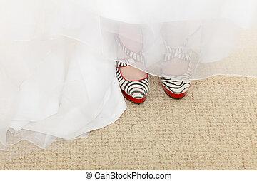 Closeup of zebra pattern shoes and wedding dress