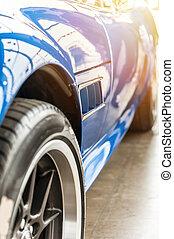 Closeup on a blue sport car