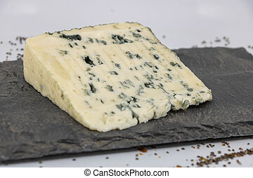 Closeup on a parsley cheese on a slate tasting tray, Bleu d'...