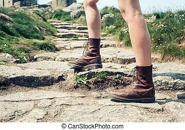 Closeup on a woman's feet as she is hiking