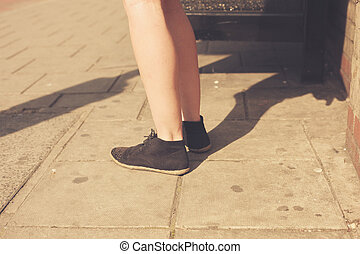 Closeup on a young woman's feet in the street