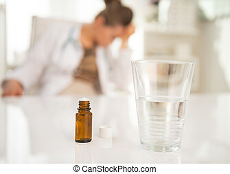 Closeup on antidepressant on table and doctor woman in...