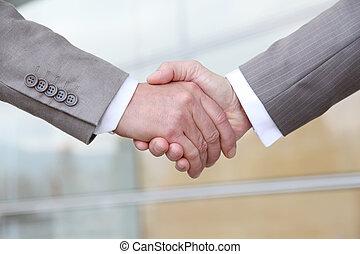 Closeup on business handshake