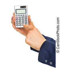 Closeup on business woman hands using calculator