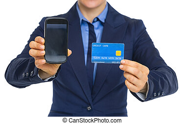 Closeup on business woman showing phone and credit card