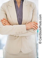 Closeup on business woman standing in office