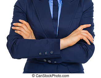 Closeup on business woman with crossed arms on chest