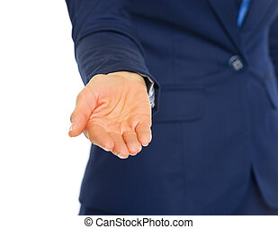 Closeup on business woman with outstretched hand