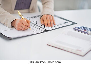 Closeup on business woman working with document