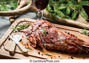 Closeup on chopping freshly baked venison