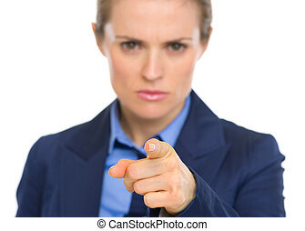Closeup on concerned business woman pointing in camera