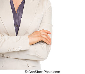 Closeup on crossed hands of business woman